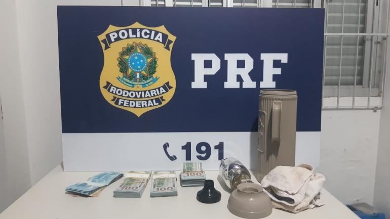 PRF apreende cerca de 30 mil dólares escondidos em garrafa térmica
